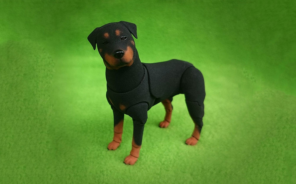 Figura de perro Rottweiler